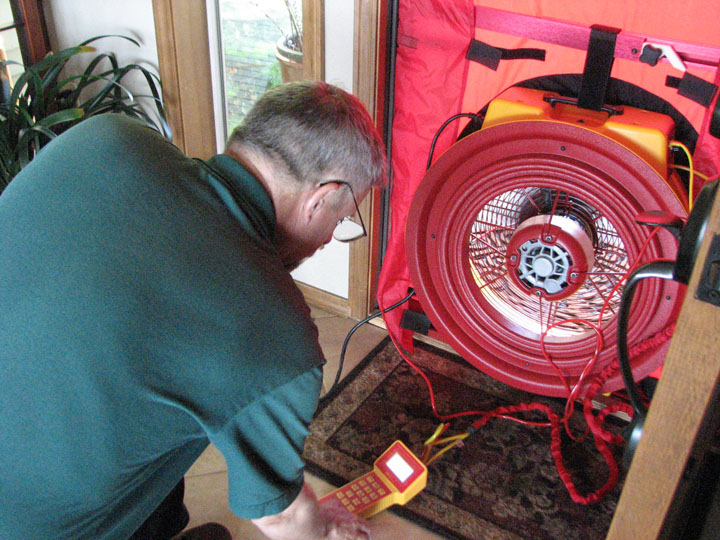 Photo of Greg Jourdan with blower door