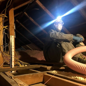 DIY blown-in insulation in Mark and Thea's historic home