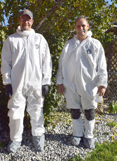Community Action crew suited up for crawlspace work