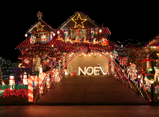 Photo of well-lit home at holidays