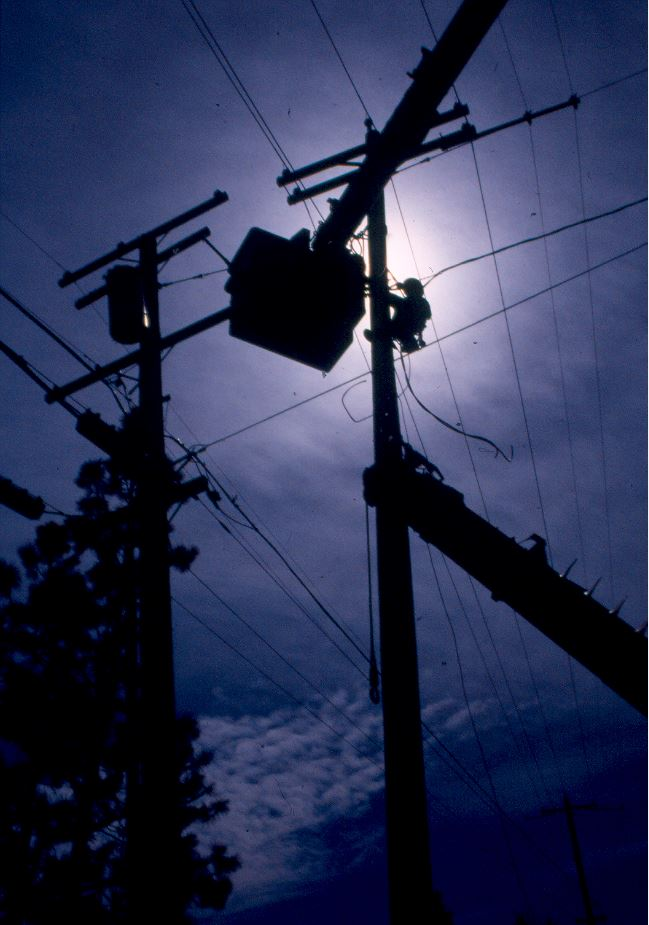 Image of power line with line crew making repairs