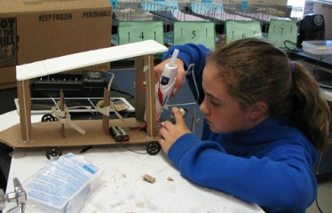 Photo of student constructing a solar car