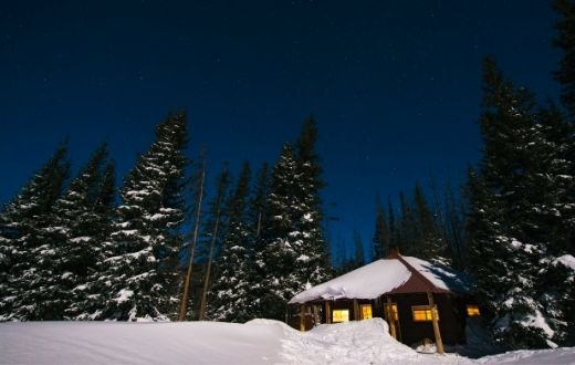 Low-Income Home Energy Assistance Program (LIHEAP) snowy home with lights on