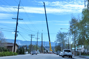 Photo of PUD crews installing a large power pole that will connect the recently completed Okanogan Substation to the rest of Chelan PUD's power system