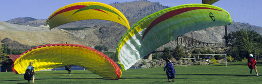 Photo of hang gliders landing at Chelan Falls Park.