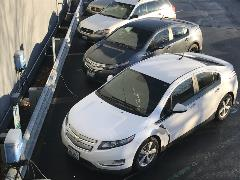 Electric car plugged into charger at PUD Headquarters