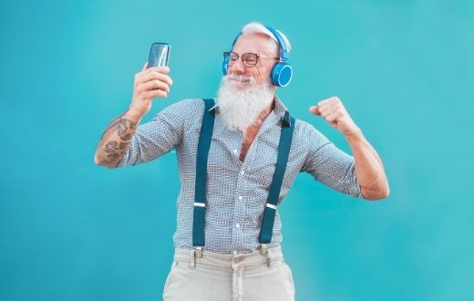 Senior discount - senior man with white hair and beard dancing