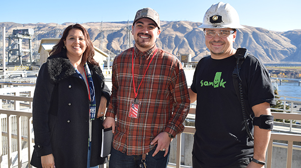 Photo of Justin Wilkinson, right, a Chelan PUD apprentice hydro mechanic, hosted Navy veteran Arik Pasche, center, during his job shadow, along with Teresa Garcia-Hernandez, WorkSource manager.