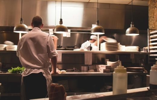 Stainless steel kitchen of a restaurant busy with activity